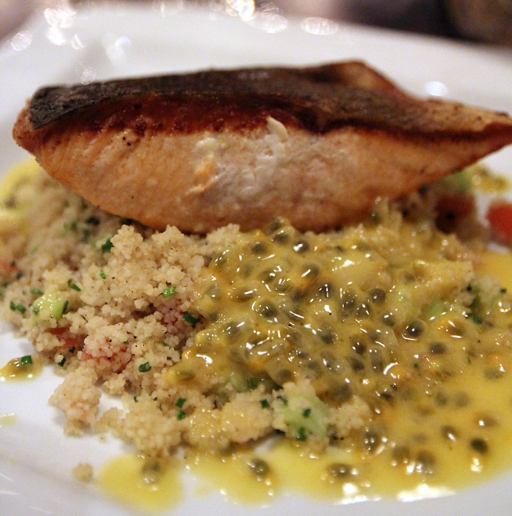 Salmon with couscous and a creamy sauce with passion fruit