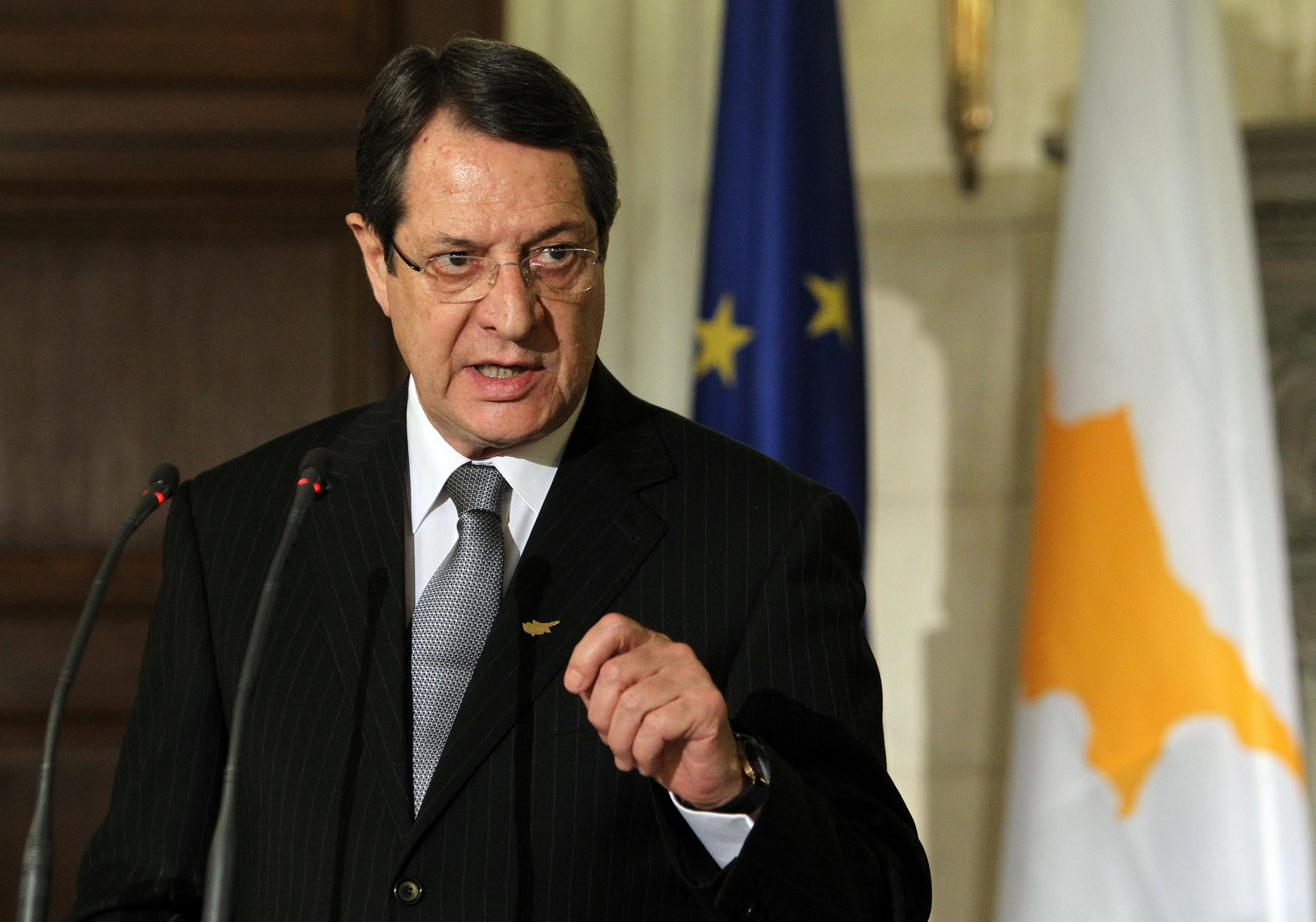 Recently-elected Cypriot President Nicos Anastasiades speaks during a news conference with Greek Prime Minister Antonis Samaras, not seen, at his official residence in Athens on Monday, March 11, 2013. A Greek official said Athens has not received any specific request for aid in recapitalizing Cyprus' ailing banks. Anastasiades is in Greece on his first official foreign visit since his election last month. (AP Photo/Thanassis Stavrakis)