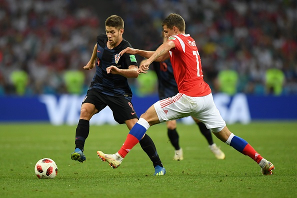 SOCHI, RUSSIA - JULY 07:  Andrej Kramaric of Croatia is challenged by Roman Zobnin of Russia during the 2018 FIFA World Cup Russia Quarter Final match between Russia and Croatia at Fisht Stadium on July 7, 2018 in Sochi, Russia.  (Photo by Shaun Botterill/Getty Images)